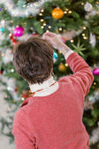 Grandmother decorating Christmas tree — Stock Photo