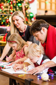 Family having fun with their children — Stockfoto