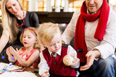 Family having fun with their children — Stock Photo