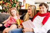 Young family at Christmas time — Stock Photo