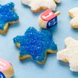 Hanukkah white and blue stars hand frosted sugar cookies — Stock Photo #60694487