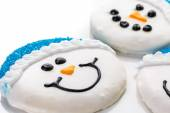 Frosted white sugar cookies in shape of snowman — Stock Photo