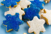 White and blue stars hand frosted sugar cookies — Stock Photo