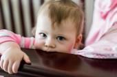 Toddler girl playing in her crib — Stock Photo