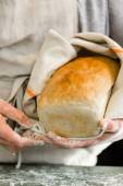 Young baker with sourdough bread — Stock Photo