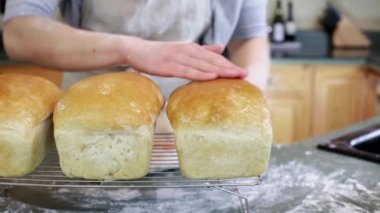 Young baker with sourdough bread — Stock Video