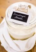 Sourdough starter in large glass jar — Stock Photo