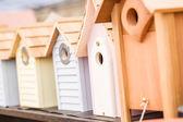 Row of wooden birdhouses — Stock Photo