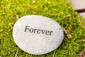 Round stone with word forever — Stock Photo