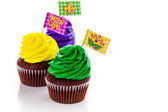 Cupcakes decorated with bright color icing — Stock Photo