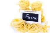 Organic yellow fettuccine nests pasta — Foto de Stock