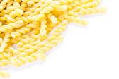 Organic yellow gemelli pasta — Stock Photo