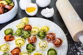 Making fresh rainbow cheese tortellini — Stock Photo