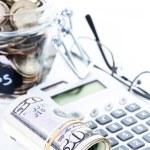 Saving money into glass jar — Stock Photo #68124219