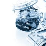 Saving money into glass jar — Stock Photo #68124337
