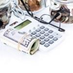 Saving money into glass jar — Stock Photo #68124407