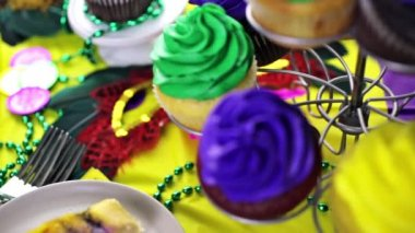 Cupcakes with colorful icing for Mardi Gras — Stock Video