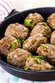 Frying large homemade Italian meatballs — Stock Photo