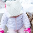 Baby girl and fresh snow — Stock Photo #69576073