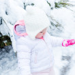 Baby girl and fresh snow — Stock Photo #69576237