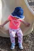 Toddler girl playing on tot lot — Stock Photo