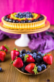 Fresh fruit tart on cake stand — Stock Photo