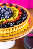 Fresh fruit tart on cake stand — Stock Photo