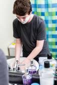 Teenage boy shaving — Stock Photo