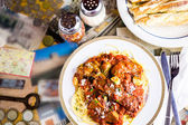 Fresh spaghetti with sausage — Stock Photo