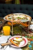 Breakfast pizza with three farm fresh eggs — Stock Photo