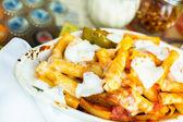 Fresh ziti pasta with sausage — Stock Photo