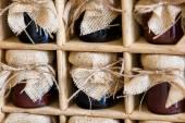 Vintage jams with burlap top — Stock Photo