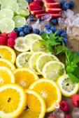 Sliced fresh organic fruits — Stock Photo