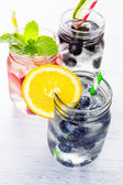 Infused water with fresh berries. — Stock Photo