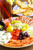 Appetizers plate with antipasto — Stock Photo