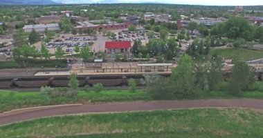 Aerial view of Downtown Littleton light rail station. — Stock Video