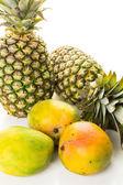 Fresh organic mango and pineapples — Stock Photo
