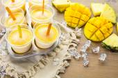 Popsicles made with mango, pineapple and coconut milk. — Stock Photo