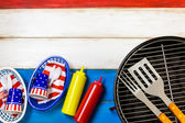 July 4th and Small round charcoal grill — Stock Photo