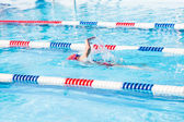 Kids swim meet in outdoor pool — Stock Photo