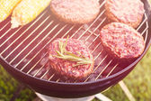 Summer picnic with corns and burgers — Stock Photo