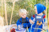 Little kids in Russian costumes — Stock Photo