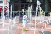 Baby girl at Splash park — Stock Photo