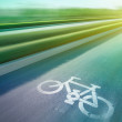 Bicycle sign on the road  in public park — Stock Photo #57163489