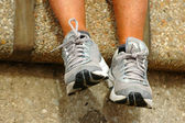 Feet wearing sneakers — Stock Photo