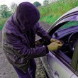 Hooligan breaking into car — Stockfoto #65053839