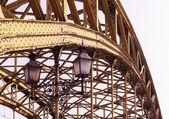 Decorative lamps hanging from bridge — Stock Photo