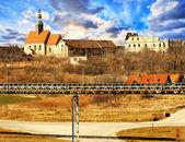 Polish village with church — Stock Photo