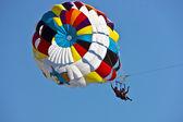 Young women parasailing. — 图库照片