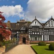 Black and white timber framed medieval mansion house and gardens. — Stock Photo #56060821